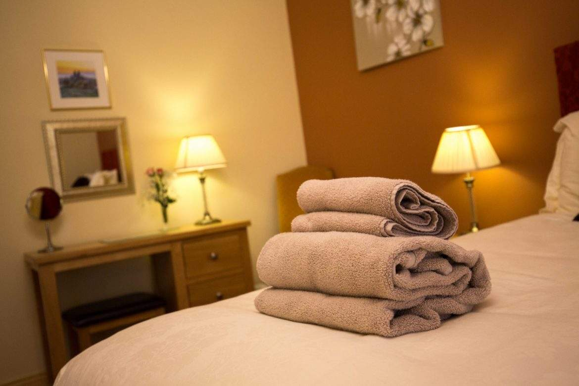 towels on the bed at broadgate farm cottages