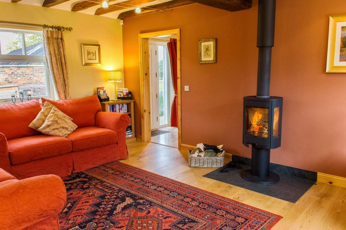 living room with woodburner in foldyard at broadgate farm cottages
