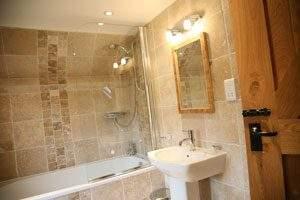 lovely bathroom with travertine tiles