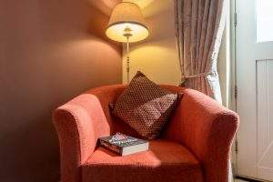 Cosy arm chair with lamp