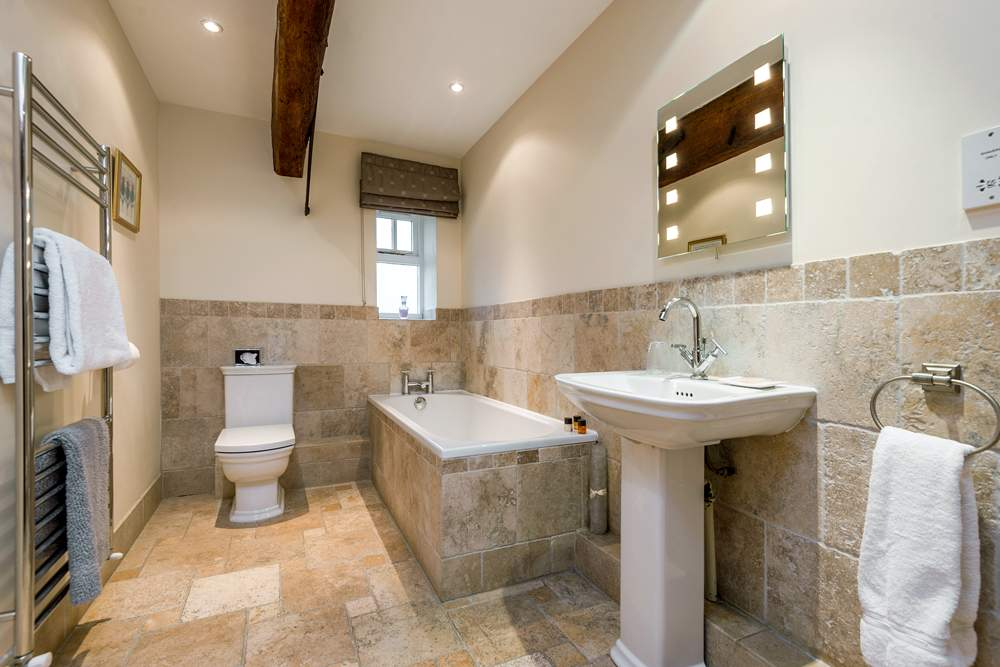 tiled bathroom with bath