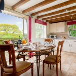 kitchen with dining table and doors onto the garden