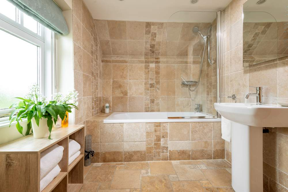 Family bathroom with shower over the bath