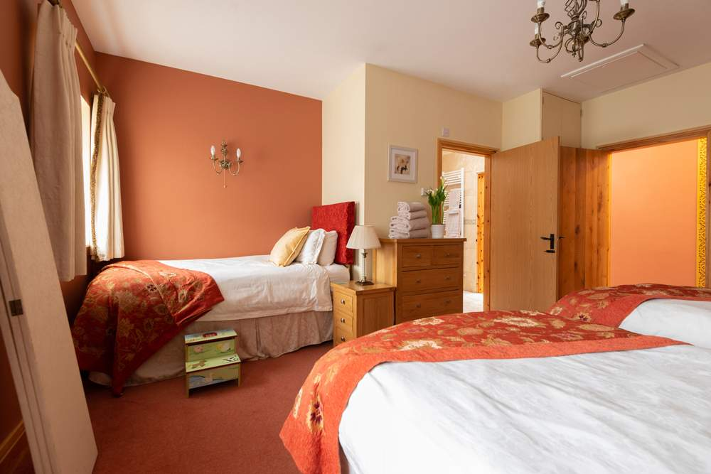 Family room with three single beds or a superking & single