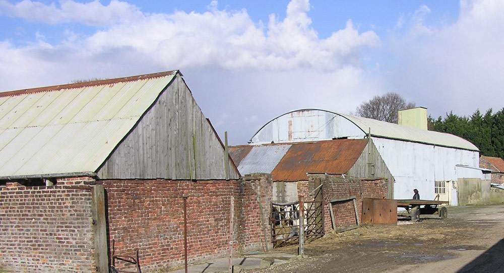 Old barns before the renovation into holiday cottages