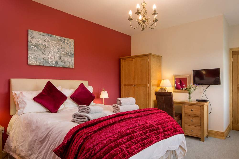 king bedroom at broadgate farm cottages